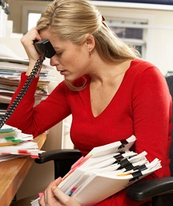 woman paperwork frustrated 300