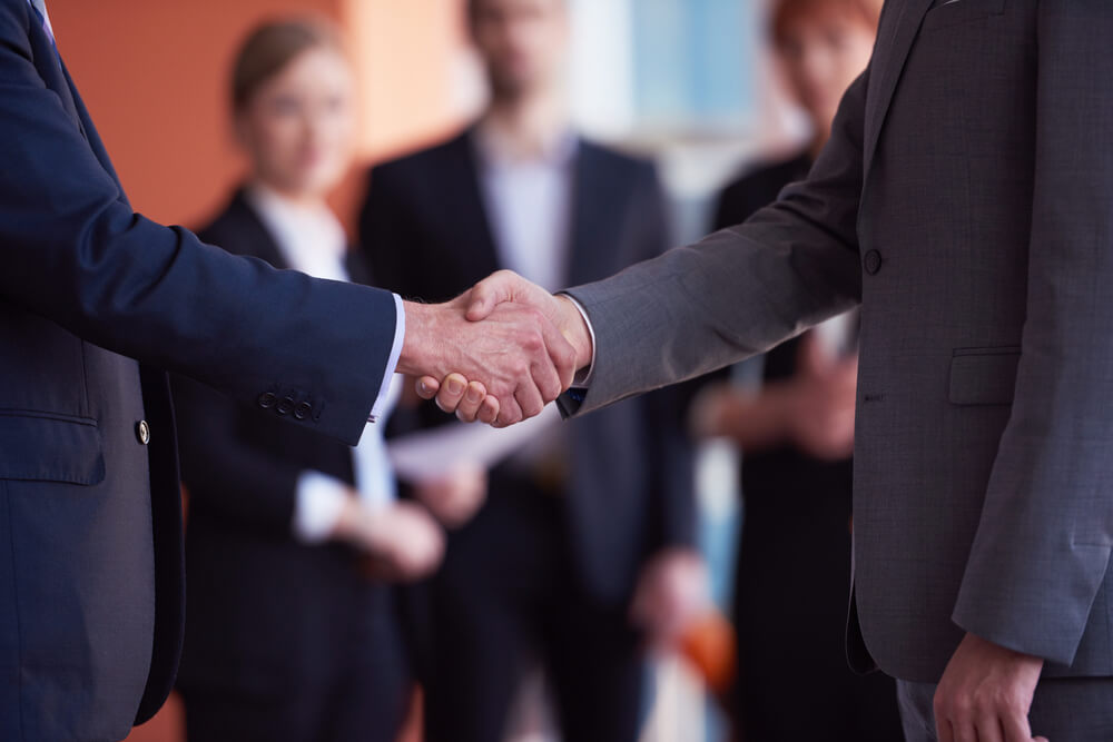 business partners, partnership concept with two businessman handshake (1)